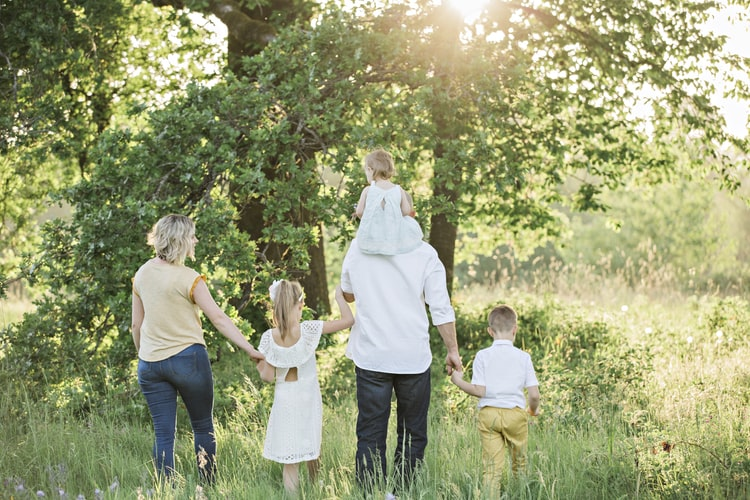 A family walking together in a wooded area
