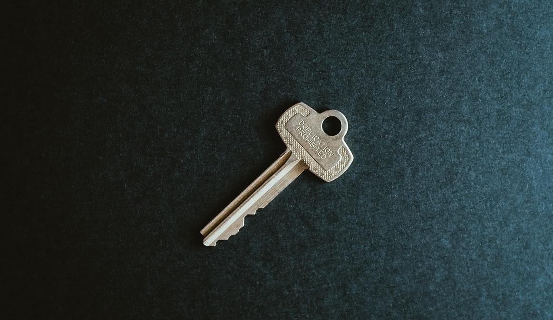 A single key on a black surface